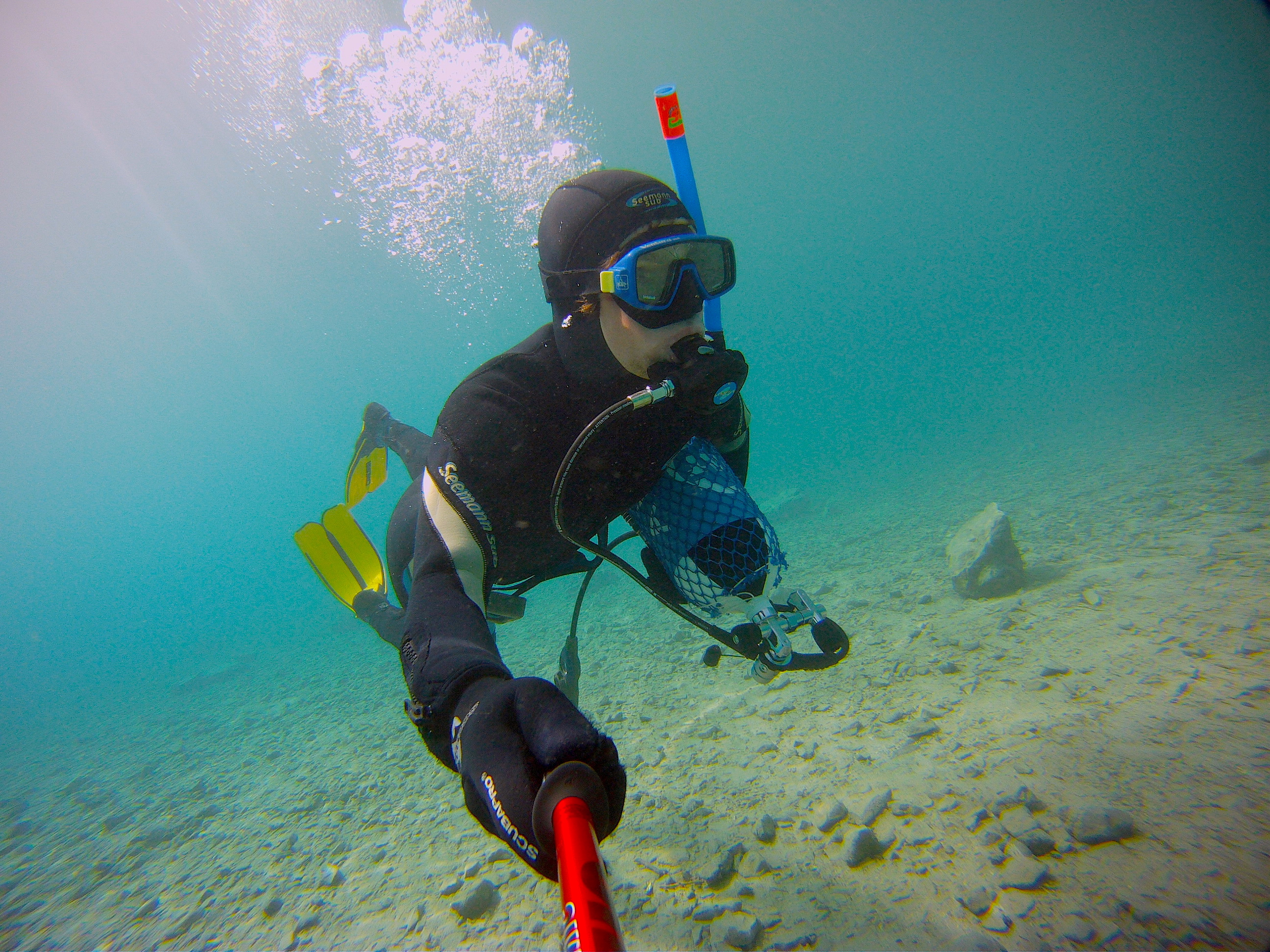 Diving gear in hand, entering the unknown